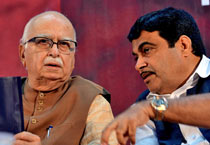 What transpired behind the scenes? Advani and Gadkari at an event on Jan 22, 2013