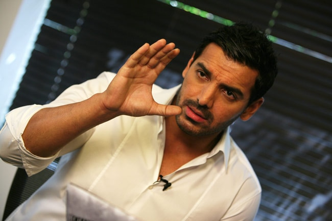 john abraham pushing fans - 650×433