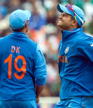 From Left: Dinesh Karthik and Suresh Raina