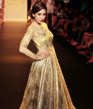 Karisma Kapoor looked ravishing in a golden dress as she walked for Vikram Phadnis.