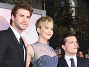 Cast of Hunger Games: Catching Fire makes a royal arrival at LA premiere