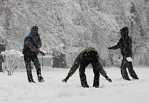 Revellers celebrate New Year eve with fresh snowfall in Srinagar