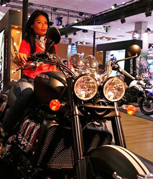 A model with Triumph motorcycle.