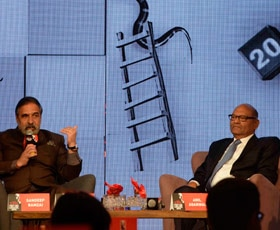 Union Minister Anand Sharma (left) and Vedanta Group Chairman Anil Agarwal