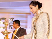 Sonam Kapoor lights inaugural lamp at FICCI Frames 2014