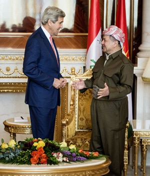 U.S. Secretary of State John Kerry, speaks with Kurdish regional President Massoud Barzani