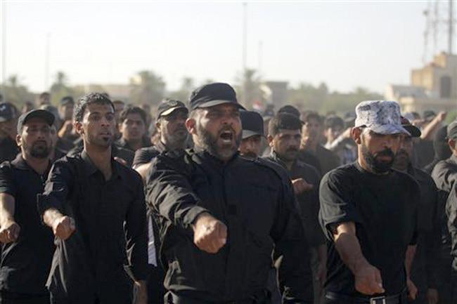 Iraqi Shiite youth train at a military base