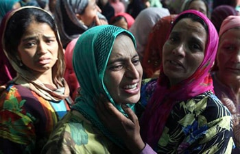 Woman attending funeral of suspected rebel Adil Ahmed Shah