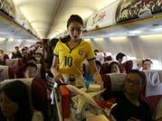 Chinese flight attendants wear Brazilian colours to celebrate World Cup