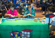 Participants compete at the National Rubik's Cube Championship at Liberty Science Center in Jersey City, New Jersey on August 1.