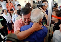 Soum Rithy (centre), who lost his father and three siblings during the Khmer Rouge regime, breaks out in tears and hugs another survivor after the verdict was delivered in the trial of former Khmer Rouge head of state Khieu Samphan and former Khmer Rouge