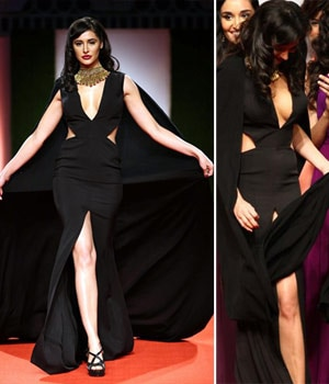 Nargis Fakhri suffers wardrobe malfunction at the Indian Bridal Fashion Week in New Delhi