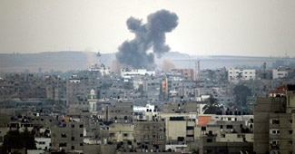 A building hit by a nearby Israeli air strike in Gaza
