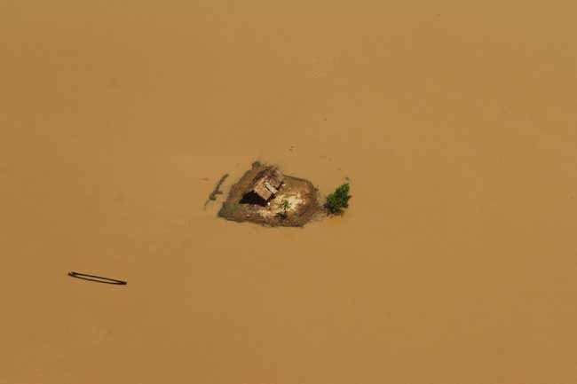 This aerial view shows a house cut-off by monsoon floods in eastern Odisha on Wednesday.