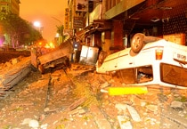 Wreckage of vehicles are seen amongst debris after an explosion in Kaohsiung, southern Taiwan, on August 1.