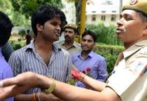 Police detains protestors outside UPSC.