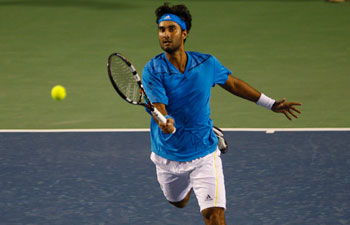 After Somdev Devvarman's outstanding victory, Yuki Bhambri lost to Filip Krajinovic on Monday in a match that was halted after two sets due to rain the previous day.