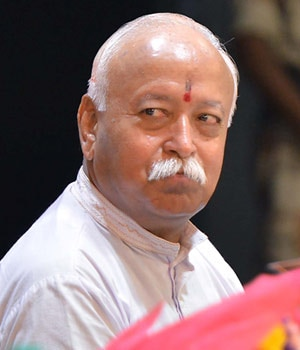 Mohan Bhagwat with Smriti Irani at a book launch in New Delhi on Sunday.