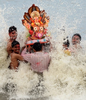Devotees carry idols of Ganesha and Gauri for immersion at the Dadar Chowpatty beach in Mumbai on September 4 after the ten-day long festival of Ganesh Chaturthi.