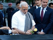 In pics: Modi pays homage to 9/11 victims