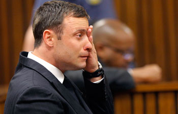 Olympic and paralympic track star Oscar Pistorius broke down and sobbed uncontrollably as he was cleared of the murder of his model girlfriend Reeva Steenkamp.