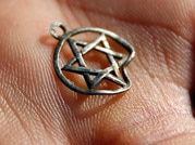 A medallion in the shape of the Star of David