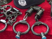 electric shock wands and neck-and-wrist cuffs connected by a chain