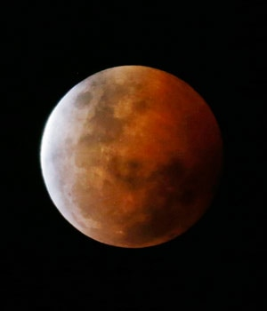 """A total lunar eclipse, as witnessed globally on October 8, is also known as a """"blood moon"""" due to the coppery, reddish color the moon takes as it passes into the Earth's shadow."""