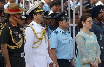 Former cricketer and honorary Air Force Group Captain Sachin Tendulkar, stands along with other officers and wife Anjali