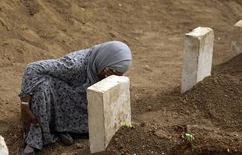 Rabia Ali mourns at the grave of her son.