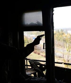 A Pro-Russian rebel with a handgun