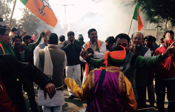 Party workers celebrated outside BJP offices in Jharkhand and Jammu and Kashmir during the counting of votes of the respective Assemblies on Tuesday, December 23.