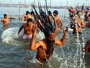 Devotees taking holy dip at Magh Mela