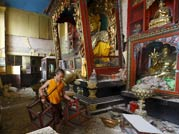A monk at the damaged monastery at Swoyambhunath Stupa