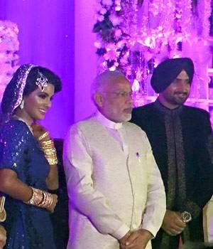 PM Narendra Modi came to bless newlyweds Harbhajan Singh and Geeta Basra at their wedding reception in Delhi.