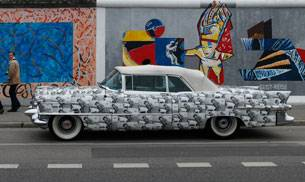 An American vintage car is parked at the East Side Gallery, the largest remaining part of the former Berlin Wall, in Berlin, Germany. Picture courtesy: Reuters