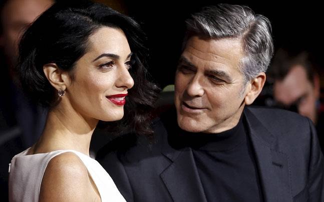 George Clooney walked the red carpet hand-in-hand with his wife Amal at the premiere of Hail Caesar in Los Angeles. The film will hit the screens in the US on February 5 this year.