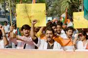 Medical students march the streets of Kolkata waving the tricolour