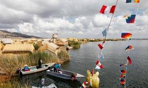 Perched high up within the mountains of Peru, is Lake Titicaca. This beautiful mountain lake is said to be the largest in South America. Located at an altitude of over 13,000 feet, it is also considered to be the highest navigable lake in the world.