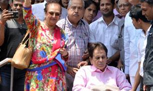 Dilip Kumar, who was admitted in Lilavati Hospital since April 15, has been discharged. The veteran actor was spotted leaving the hospital along with his wife Saira Banu.