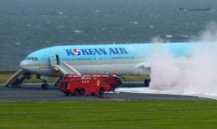 A Korean Air Boeing 777 had to be evacuated at Tokyo's Haneda airport after one of its engines caught fire. (AP Photo)