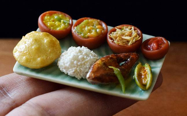 Shilpa Mitha is a miniaturist with an eye for details, and it shows in these beautiful, tiny platters of food, that are so realistic but made of clay.