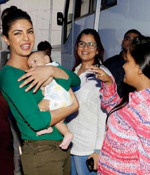 While Priyanka Chopra looks stunning in the new poster of Baywatch, the Mary Kom actor had cute little moments with Salman Khan's little nephew Ahil.