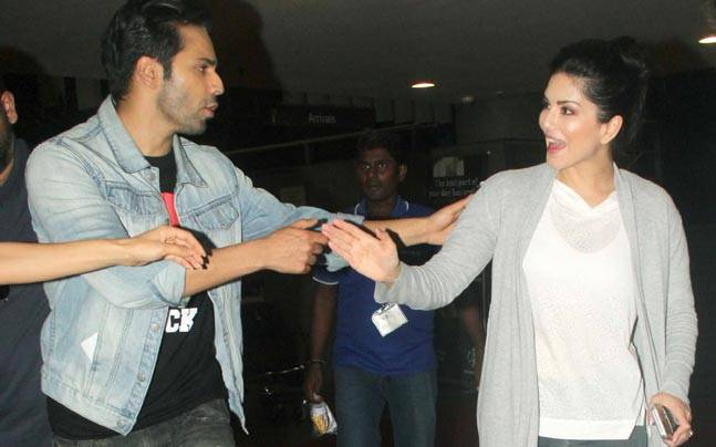 While Varun Dhawan and Sunny Leone were spotted at the Mumbai international airport sharing a light moment, Ranveer Singh was clicked outside Farhan Akhtar's Excel Entertainment office.