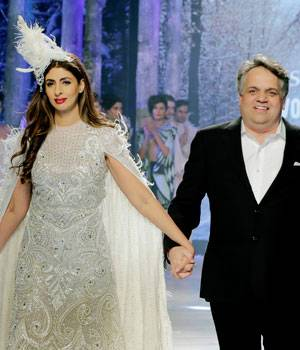 With Amitabh, Jaya, and Abhishek Bachchan cheering her on from the front row, Shweta walked down the ramp in a white embellished dress.