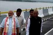 PM Narendra Modi takes a tour of the Dhola-Sadiya bridge.