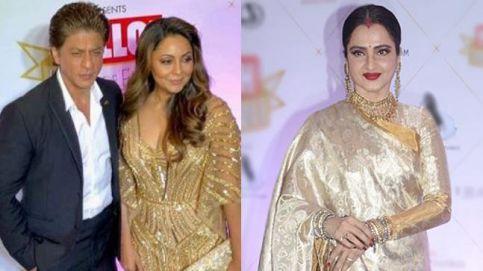Shah Rukh-Gauri Khan and Rekha on a red carpet.