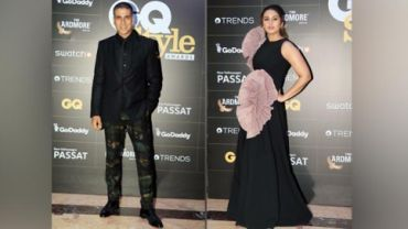 Akshay Kumar and Huma Qureshi on a red carpet.