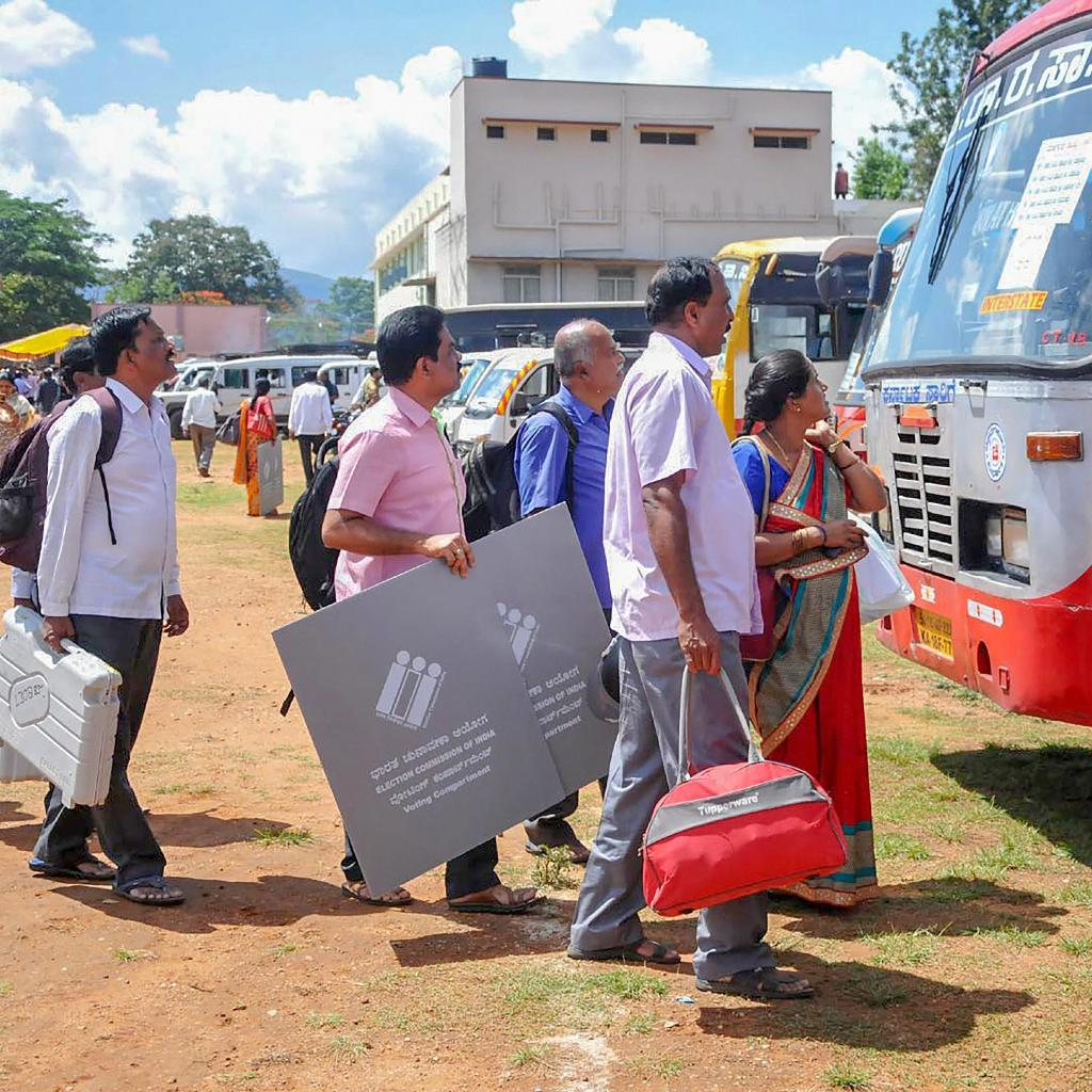 Polling officials collect EVMs and other election material
