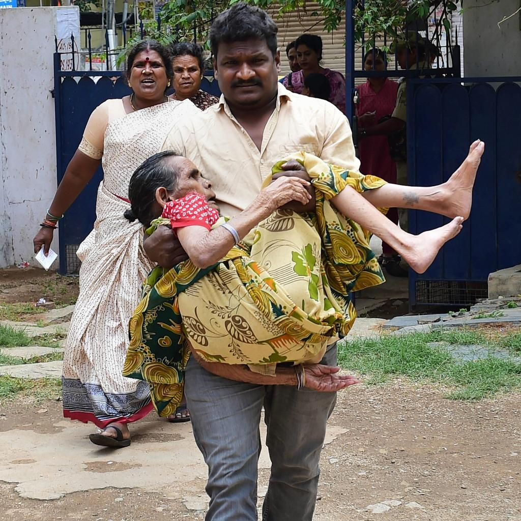 Bengaluru: A elderly woman being taken to cast her vote during polling day for the Karnataka Assembly election 2018 in Bengaluru on Saturday.